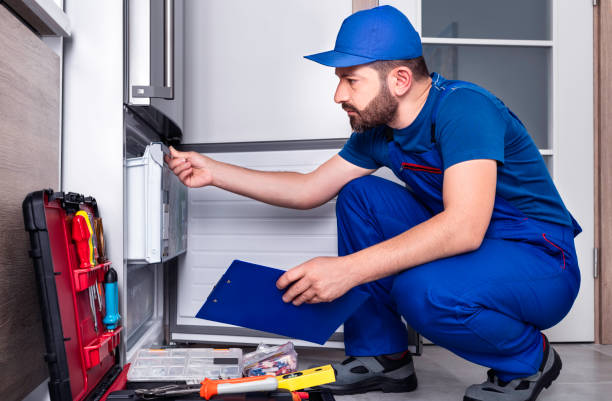 electrician fixing refrigerator
